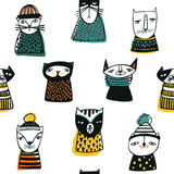Seamless pattern with funny cartoon cats muzzles. Hand drawn doodle kitty on white background. Stock Photography