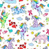 Seamless illustration  with funny cartoon unicorns, hearts and stars color icons on white background Stock Photography
