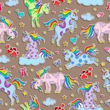 Seamless illustration  with funny cartoon unicorns, hearts and stars color sticker icons on brown  background. Seamless pattern with funny cartoon unicorns Royalty Free Stock Photos