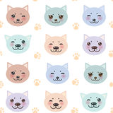 Seamless pattern funny cat muzzle and paw prints Stock Images