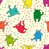 Seamless pattern with funny cats. Color funny cats with traces of paws on seamless vector pattern Stock Image