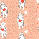 Seamless pattern with Funny cats and orange hearts Royalty Free Stock Photos