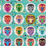Seamless pattern with funny colored owls on a turquoise background.  Royalty Free Stock Image