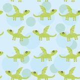 Seamless pattern with funny cute dragon on a blue Stock Images
