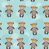 Seamless pattern with funny cute monkey animal on. A blue background. Vector monkey primate clip-art Stock Photo