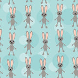 Seamless pattern with funny cute rabbit animal on. Blue background Vector bunny, spring doodle easter Stock Photography