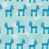 Seamless pattern with funny cute unicorn animal on Stock Photos