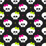 Seamless pattern with funny halloween skulls over black Royalty Free Stock Photo
