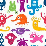 Seamless pattern with funny monsters. Royalty Free Stock Photo