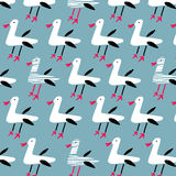 Seamless pattern of funny seagulls on blue background. Hand drawn Stock Images