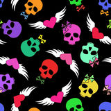 Seamless pattern of funny skulls and winged hearts Stock Image