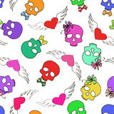 Seamless pattern of funny skulls and winged hearts Stock Photos