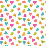 Seamless pattern with funny smiley hearts.  Royalty Free Stock Photos