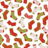 Seamless pattern of funny socks on a white background. Christmas socks. Vector illustration of hand drawn flat style. stock illustration