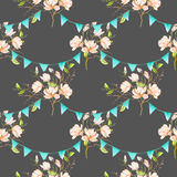 Seamless pattern with garlands of the blue flags on spring magnolia tree branches Stock Images