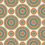 Seamless pattern with geometric figures. Repeated circles wallpaper. Abstract background with bright colors vortexes. Seamless pattern with geometric figures Stock Illustration