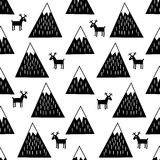 Seamless pattern with geometric snowy mountains and reindeers. Cute winter mountains background. Stock Photo