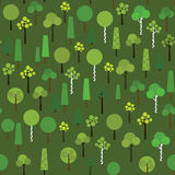 Seamless pattern with geometric trees on a dark green background. Stock Images