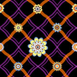 Seamless pattern with a geometrical ornament and flowers. Stock Images