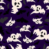 Seamless pattern of ghosts and bats. Vector Royalty Free Stock Photography