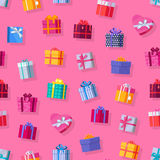 Seamless Pattern Gift Boxes. Colorful wrapped gift boxes. Beautiful present box with overwhelming bow. Various gift boxes on pink background. Gift symbol Royalty Free Stock Photography