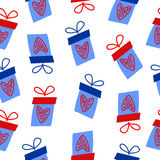 Seamless pattern with gift boxes. With hearts on a white background Stock Photos