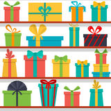Seamless pattern of gift boxes on the shelves. Gift shop. Stock Photo