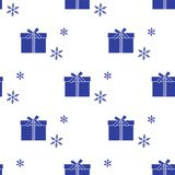 Seamless pattern with gift boxes and snowflakes. Seamless pattern with gift boxes tied with ribbons and snowflakes. Design for postcard, invitation, banner Royalty Free Stock Images