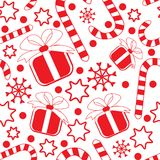 Seamless pattern with gifts, candy canes and stars Stock Images