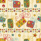 Seamless pattern with gifts and stars Stock Photography