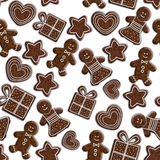 Seamless pattern with gingerbread cookies isolated over white Royalty Free Stock Photos