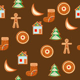 Seamless pattern of gingerbread figures on bright festive. Background Stock Images
