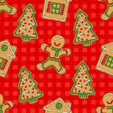 Seamless Pattern. Gingerbread Man, House and Tree. Seamless Pattern with Gingerbread Man, House and Tree on a Red Plaid Background Royalty Free Stock Images
