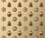 Seamless pattern of gingerbread sweets golden wrapping paper. Royalty Free Stock Photo