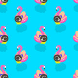 Seamless pattern with girls on an inflatable pink flamingo in summer of swims and rests. Vector illustration Royalty Free Stock Image