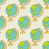Seamless pattern: a globe on a light background. A globe on a light background. Seamless pattern Royalty Free Stock Photos