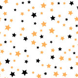 Seamless pattern with gold and black stars. Vector illustration. Stock Photography