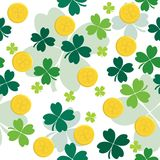 Seamless pattern with gold coins and clover leaves Stock Photos