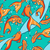 Seamless pattern of gold fishes in water. Royalty Free Stock Photos