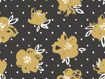 Seamless pattern with gold flowers on the dark polka dot background. Stock Photo