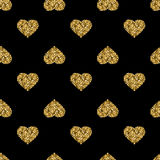 Seamless pattern with gold glitter hearts on black background Stock Photos