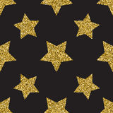Seamless pattern with gold glitter textured stars on the dark background Royalty Free Stock Images