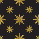 Seamless pattern with gold glitter textured stars on the dark background Stock Photography