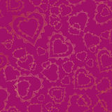 Seamless pattern of gold lacy hearts Stock Photography