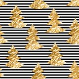 Seamless pattern with gold leaf textured spruces on the striped background Royalty Free Stock Image