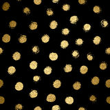 Seamless pattern with gold painted dots on the black backgrounds Stock Photo