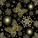 Seamless pattern with gold snowflakes and butterflies Stock Photo
