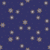 Seamless pattern with gold snowflakes. Winter dark blue background Stock Photos