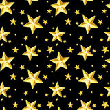 Seamless pattern with gold stars on black. Royalty Free Stock Photography