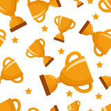 Seamless pattern with gold winners cup. And stars Royalty Free Stock Photos